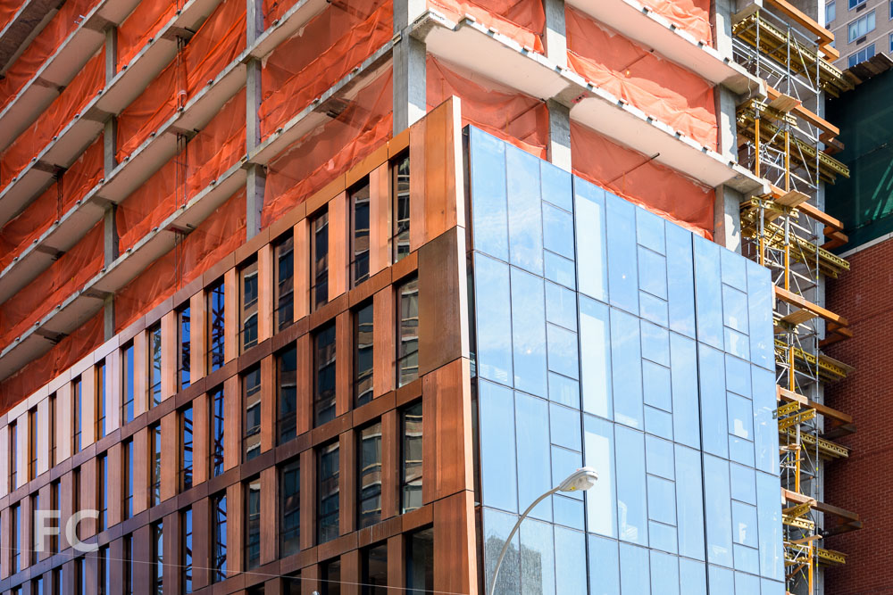 Closeup view of the copper and glass facade on the northwest corner of the north tower.
