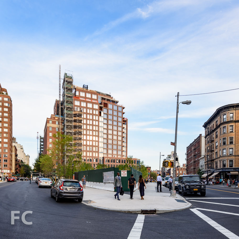 West façade from Greenwich Avenue with the new West Village Park in the foreground.