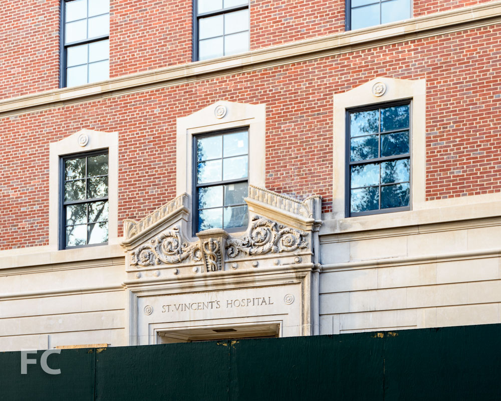 The entry to 145 West Eleventh Street with original detailing from the old St. Vincent's Hospital.