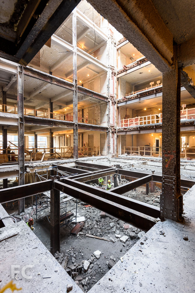 The atrium opening under construction at a lower floor.