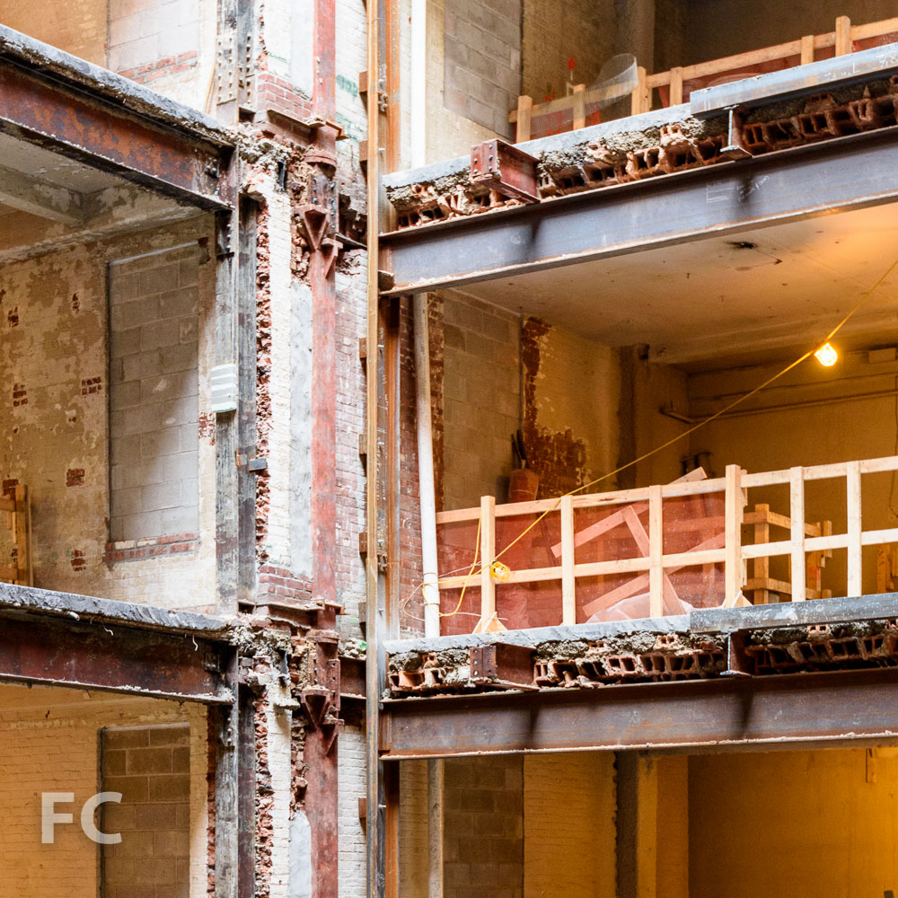 A view of the existing steel and terra cotta floor construction revealed by the atrium opening.