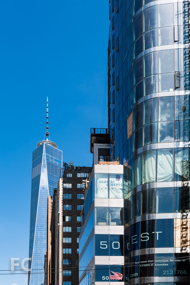Close-up of the southwest corner of 50 West (right) and One World Trade Center (left).