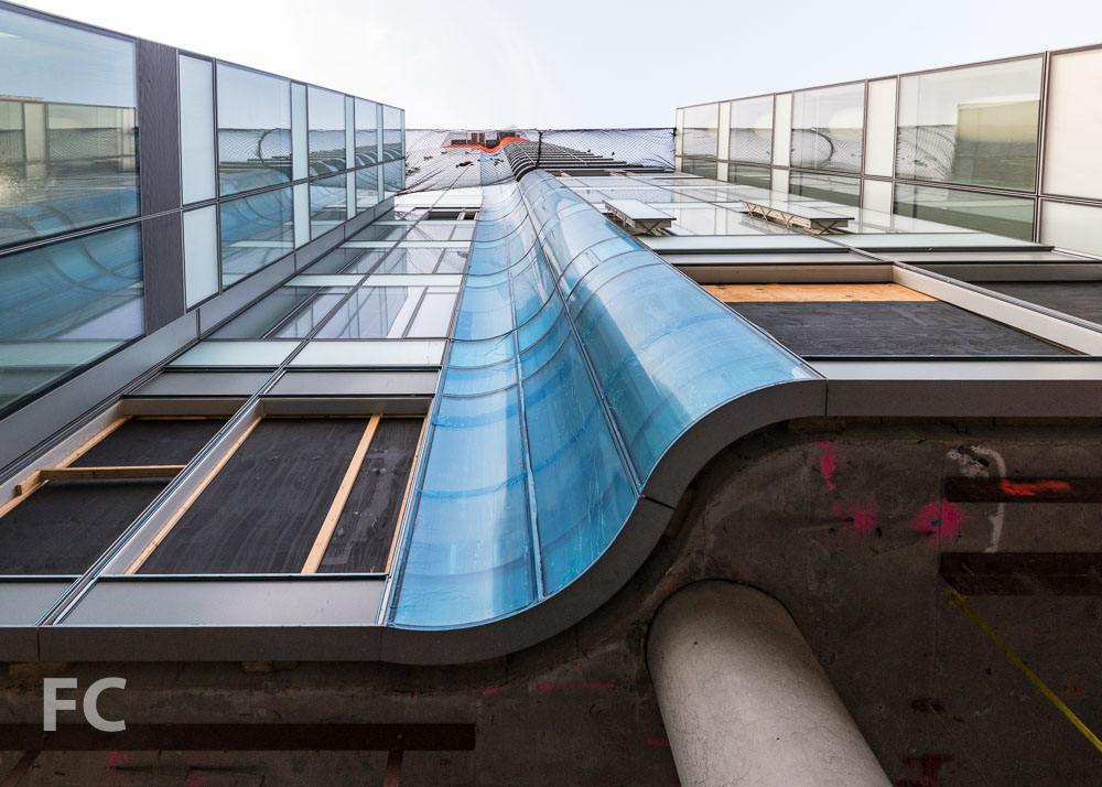 Looking up at the curved glass element on the north façade.