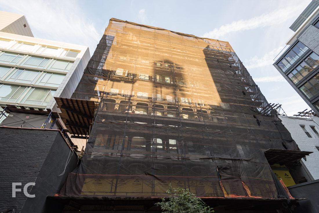 Courtyard facade still under construction scaffolding.