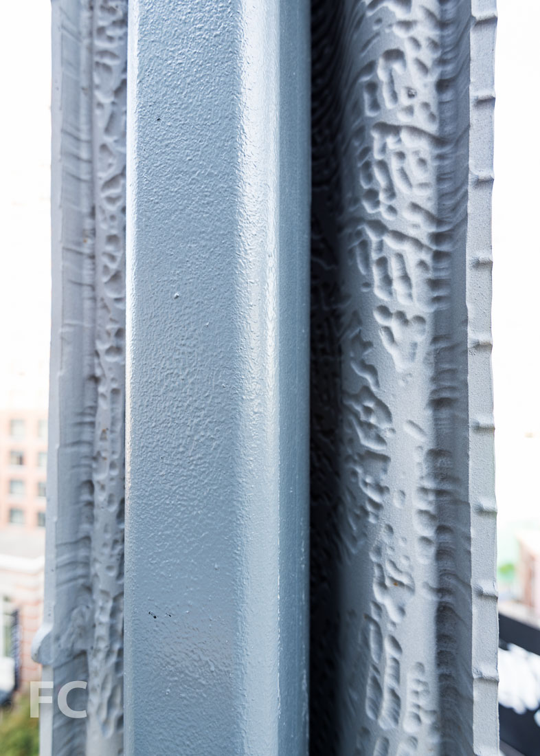 Hand imprint on the interior face of the facade screen.