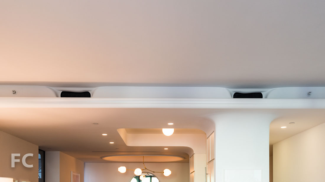 Living room soffit to conceal sprinklers and air conditioning vents.