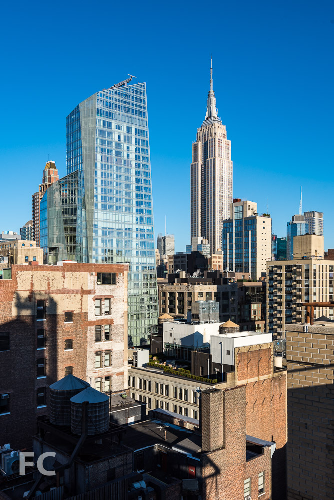 View northeast with Empire State Building (right) and 400 Park Avenue South (left).