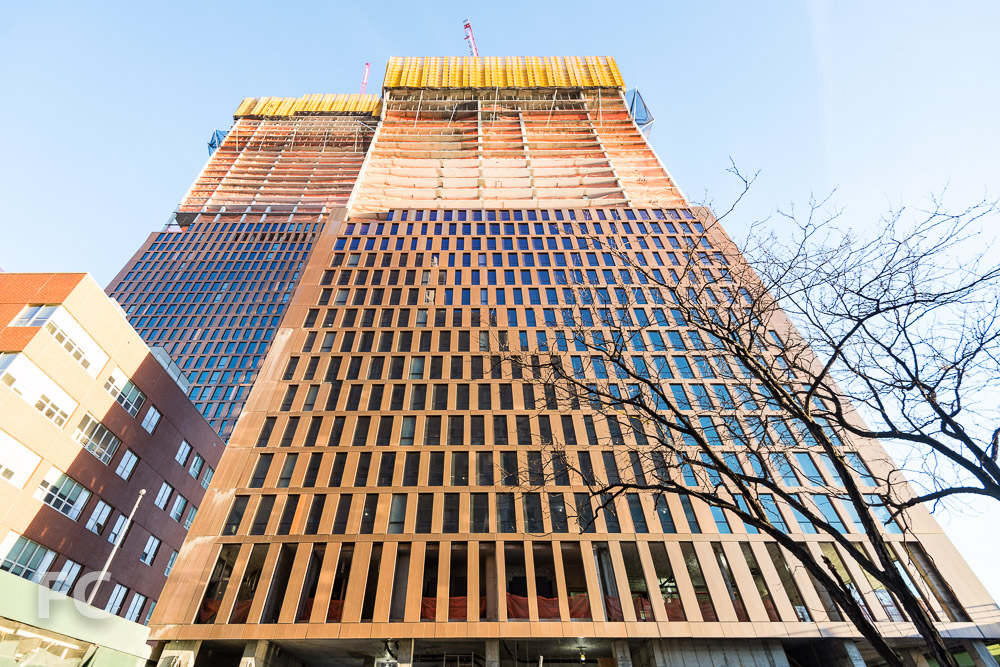 Looking up at the south facade of the north (left) and south (right) towers from East 35th Street.