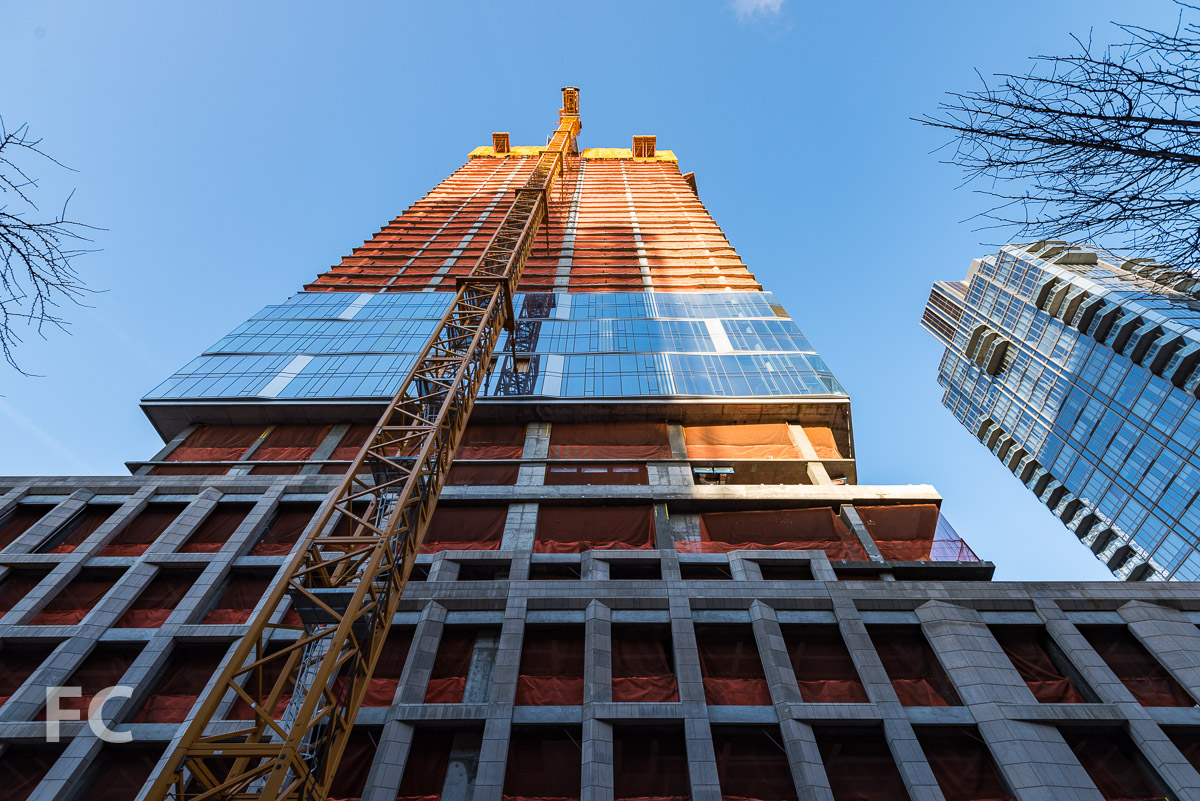 Looking up at the south facade from West 59th Street.