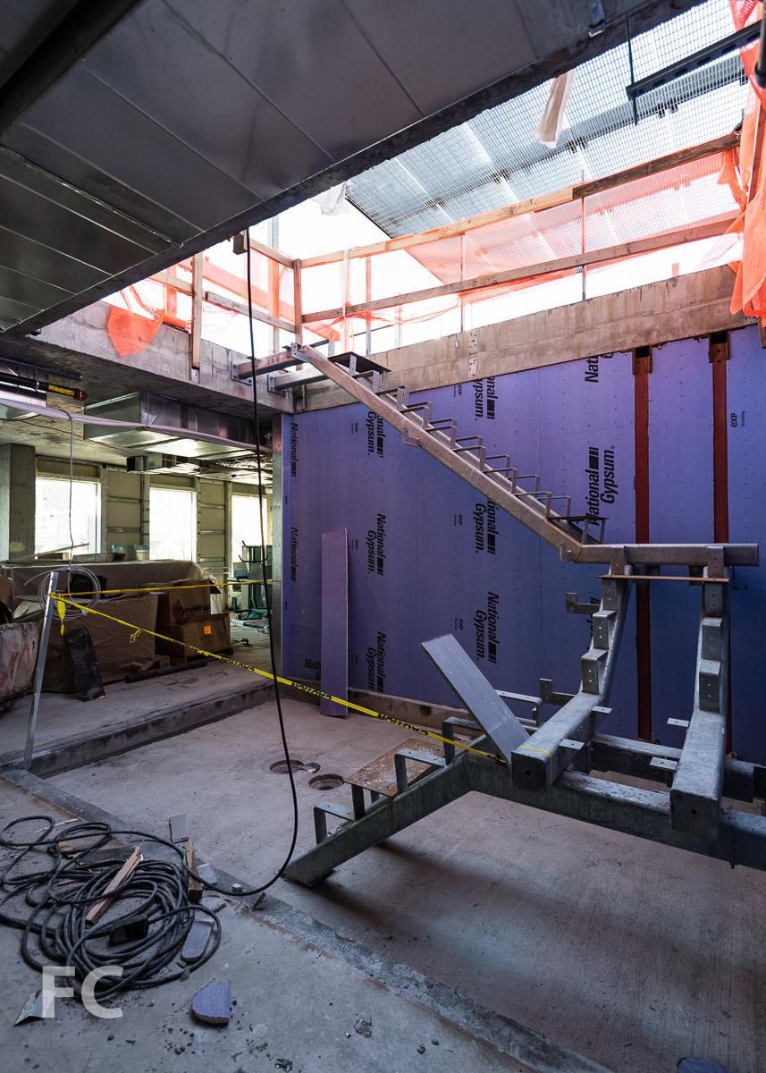 Stair under construction inside a penthouse unit's sunken courtyard.