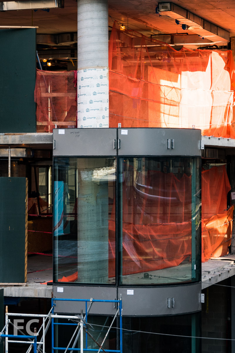 Curved glass curtain wall at the southeast corner.
