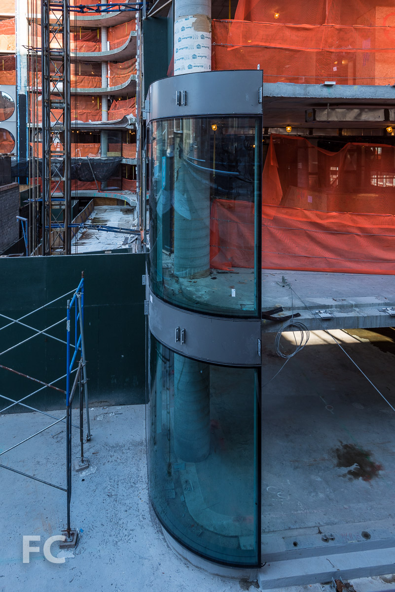 Curved glass curtain wall at the northeast corner.