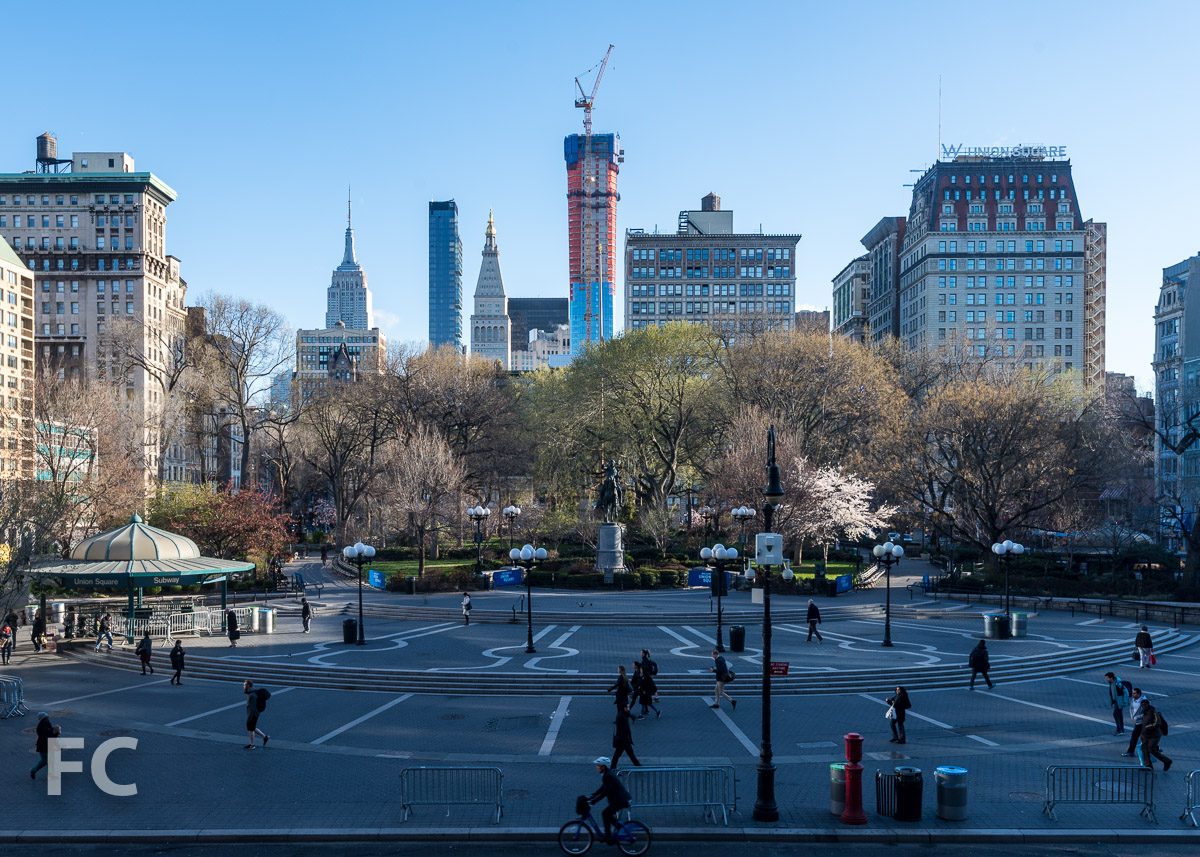 45 East 22nd Street (center)rising above Union Square.