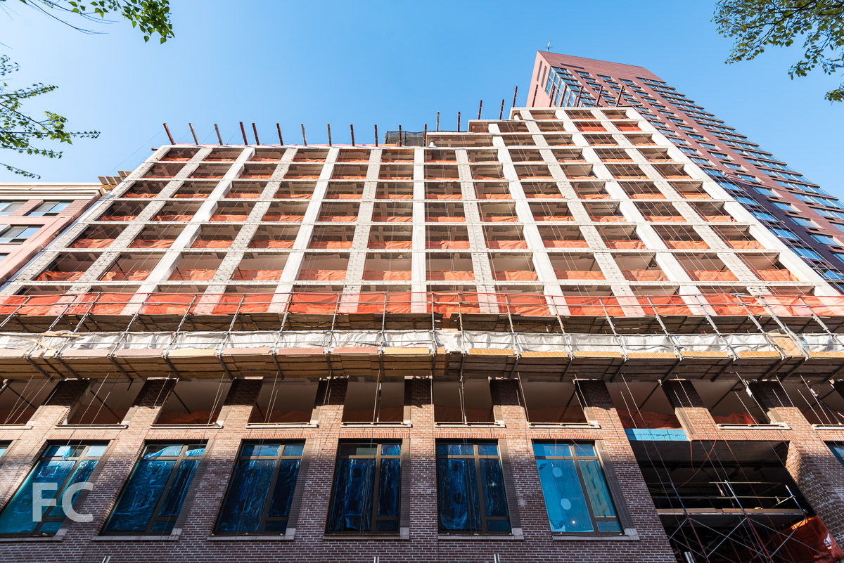 Looking up at the south facade from West 52nd Street.
