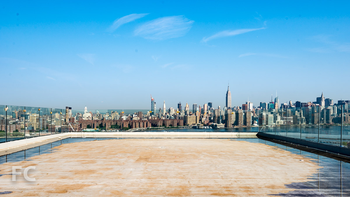 Panoramic view of Manhattan from the rooftop event space under construction.
