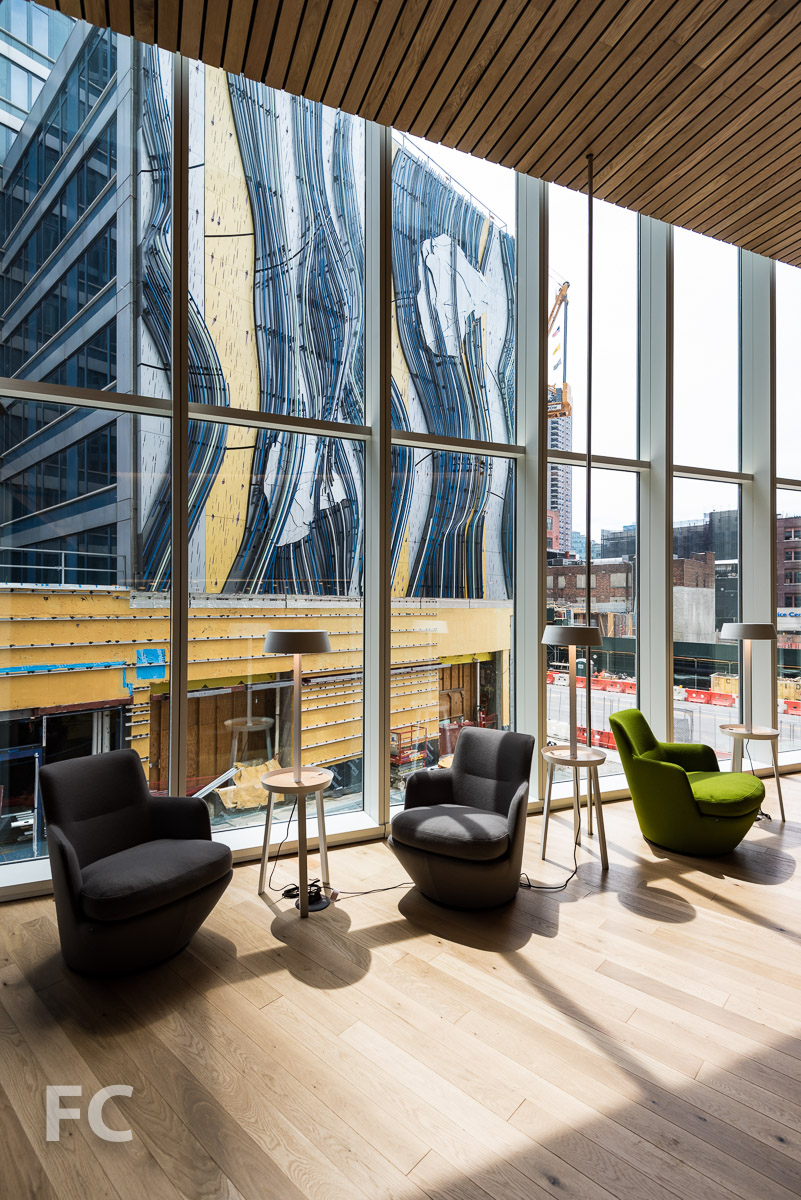 """East resident lounge seating with a view of Stephen Glassman Studio's """"Flows Two Ways."""""""