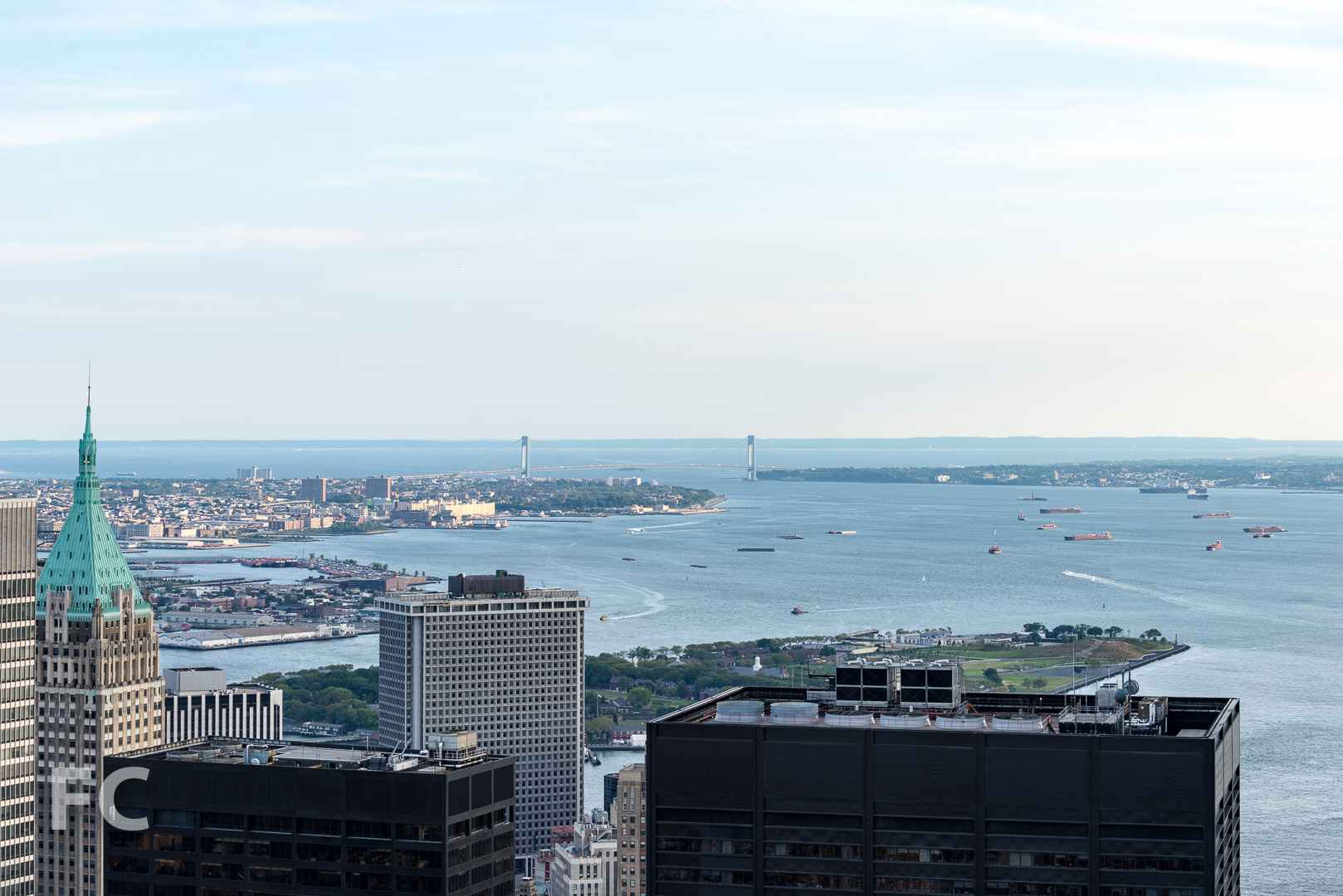 Governors Island and the evening rush hour traffic in the New York harbor.