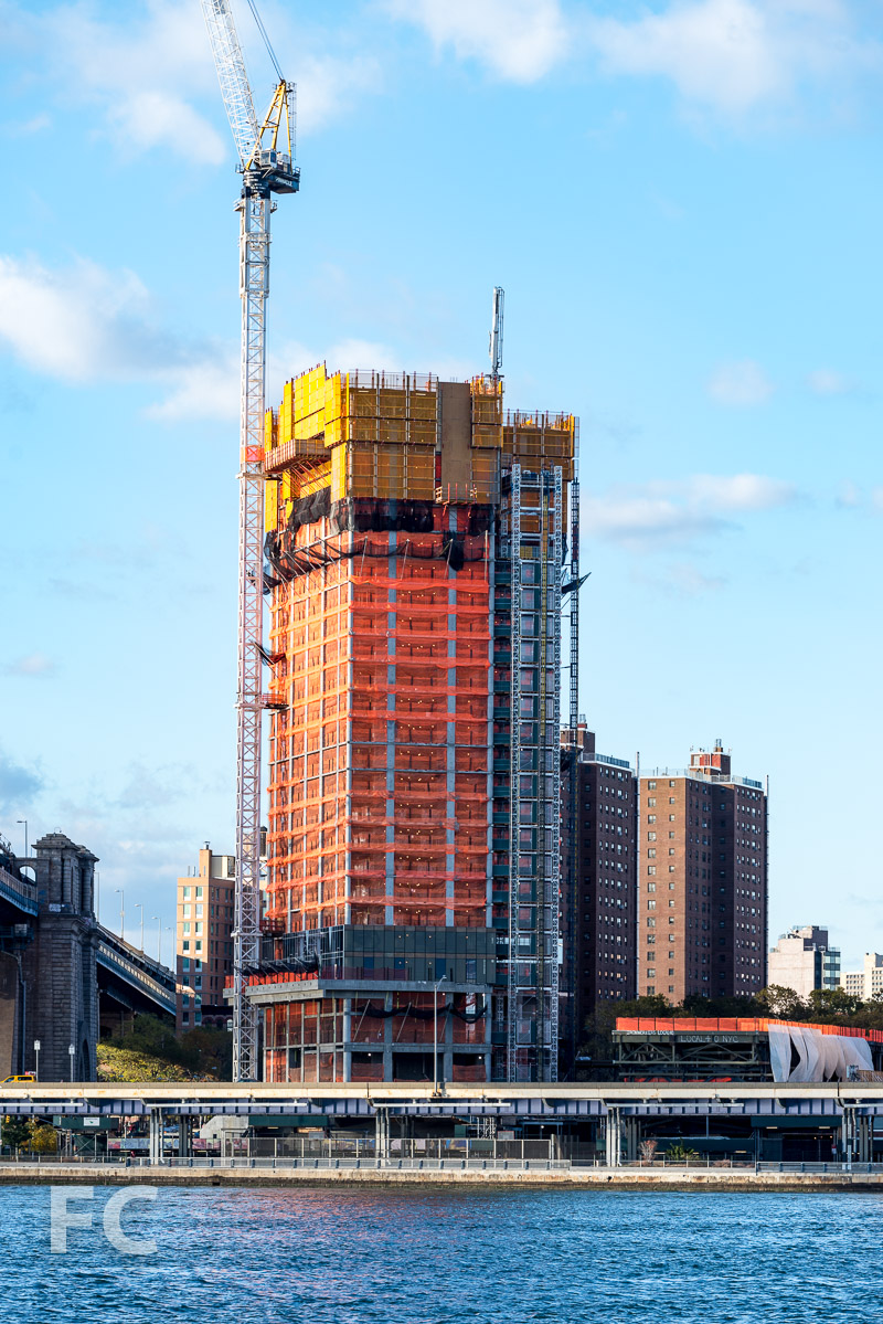 One Manhattan Square rising on the East River waterfront.