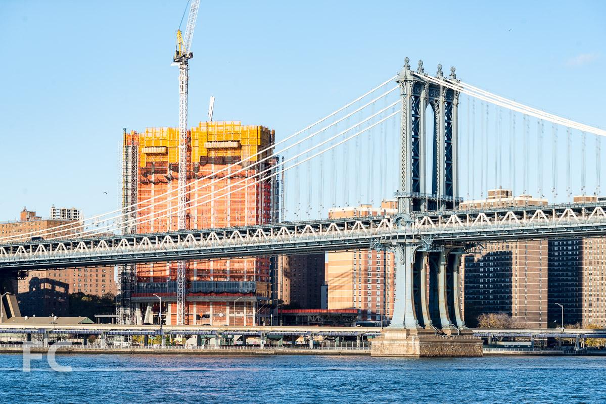 One Manhattan Square rising next to the Manhattan Bridge.