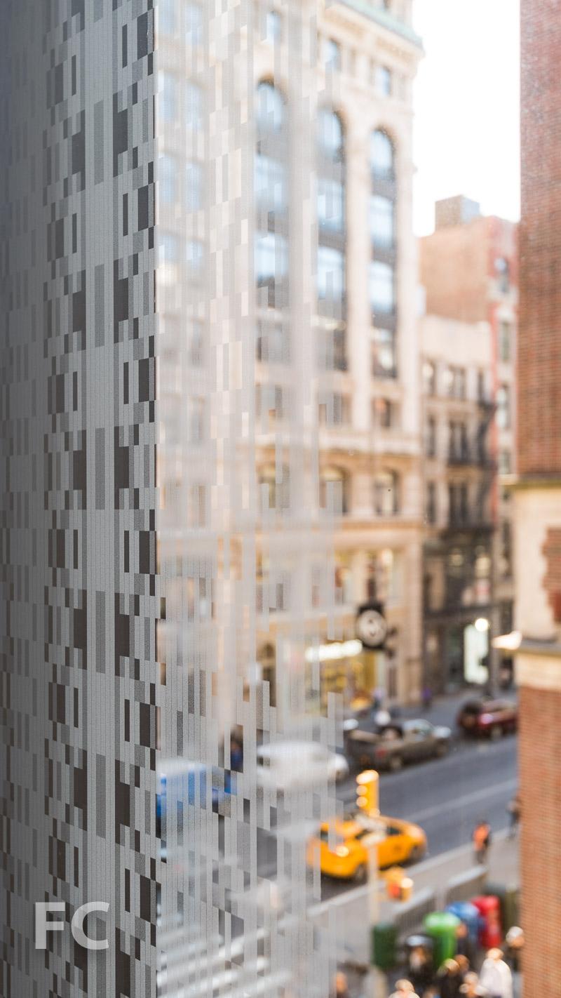 Frit pattern surrounding the glass panels.