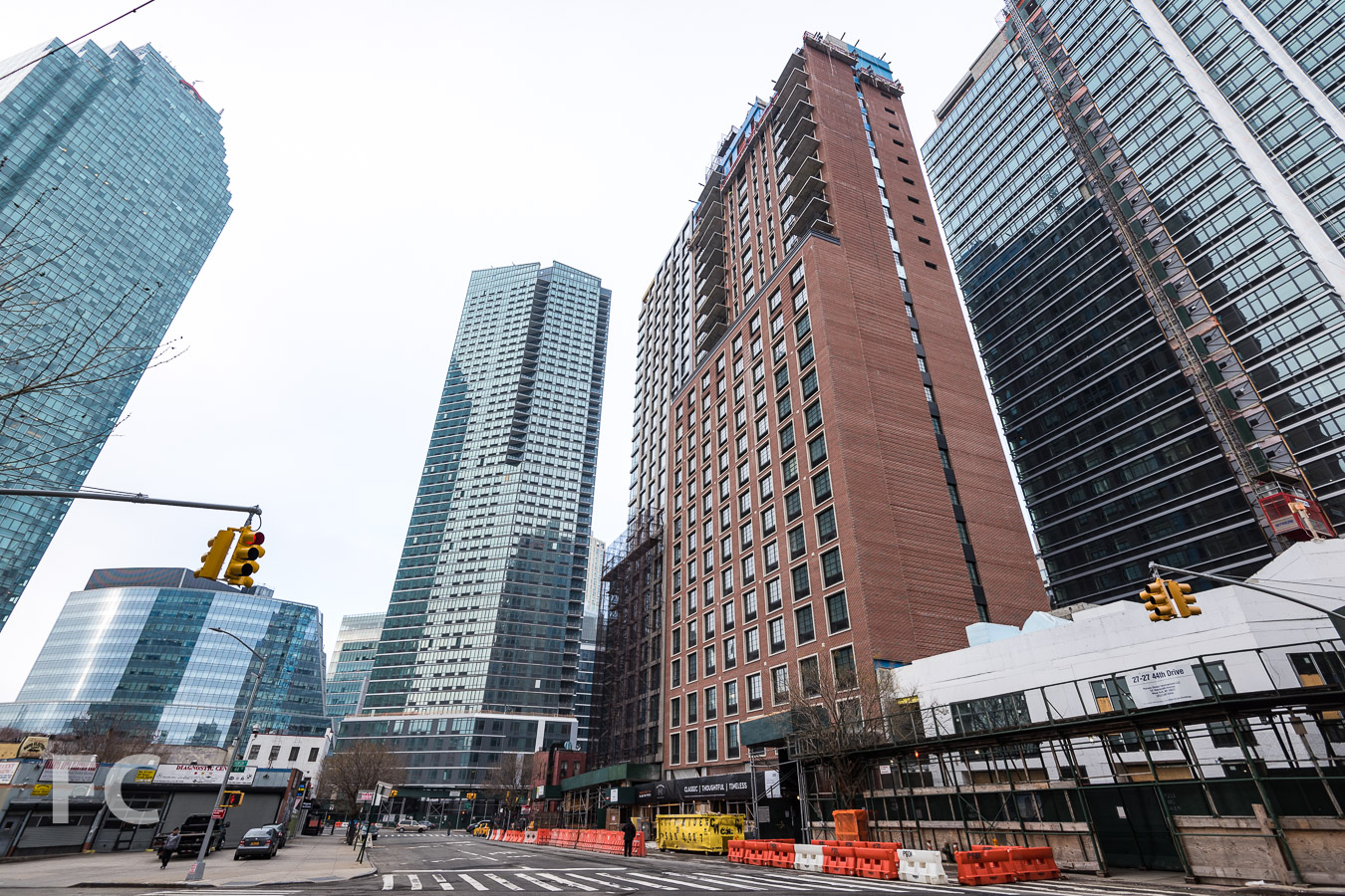 Looking north from the intersection of 44th Drive and Thomson Avenue with The Hayden (left), Watermark Court Square (center),The Edison (right), and 44-28 Purves Street (far right).