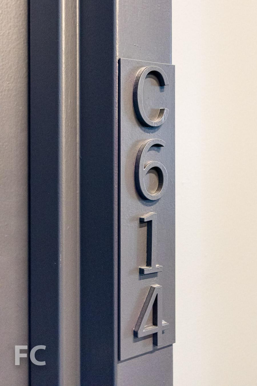 Unit number entry signage.