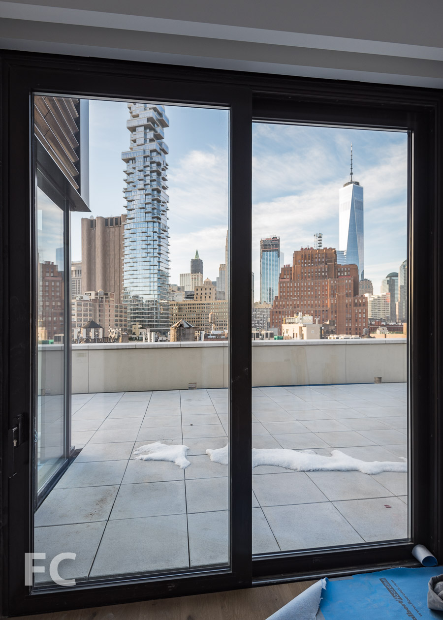 View of the Lower Manhattan skyline from the foyer of the roof terrace of Penthouse B.