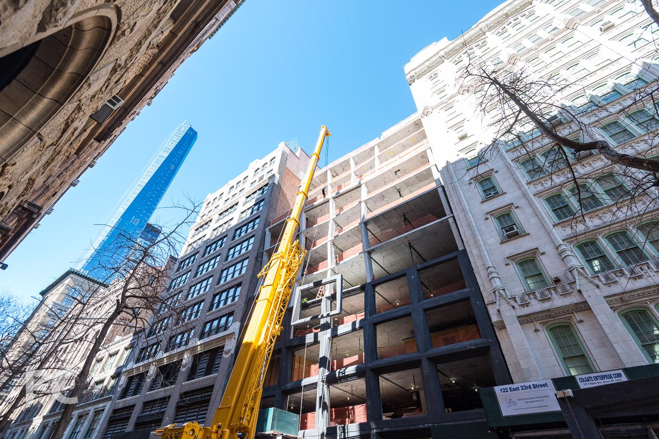Crane lifts precast panel into place on the East 22nd Street façade.