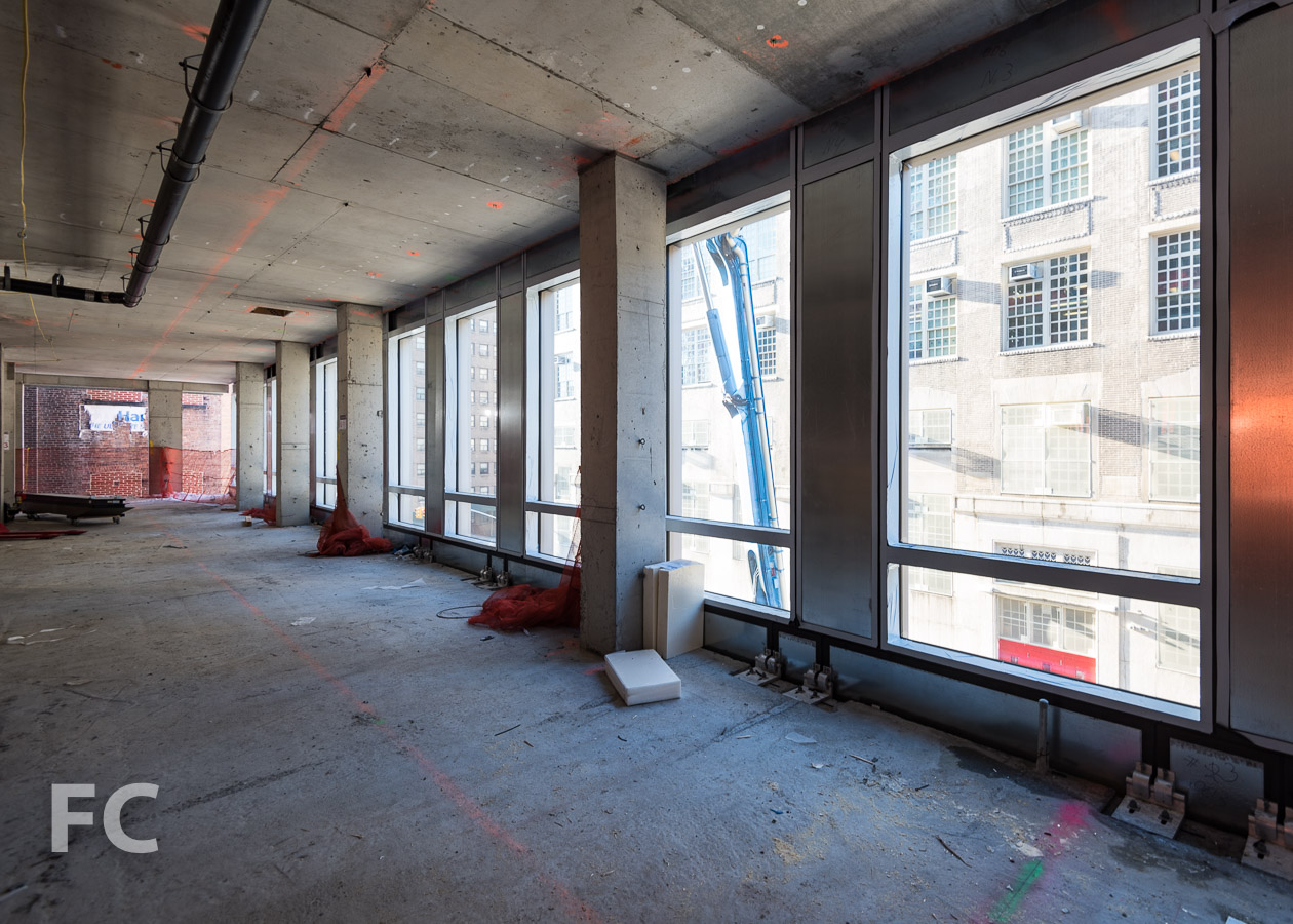 Curtain wall panels installed on the third floor.