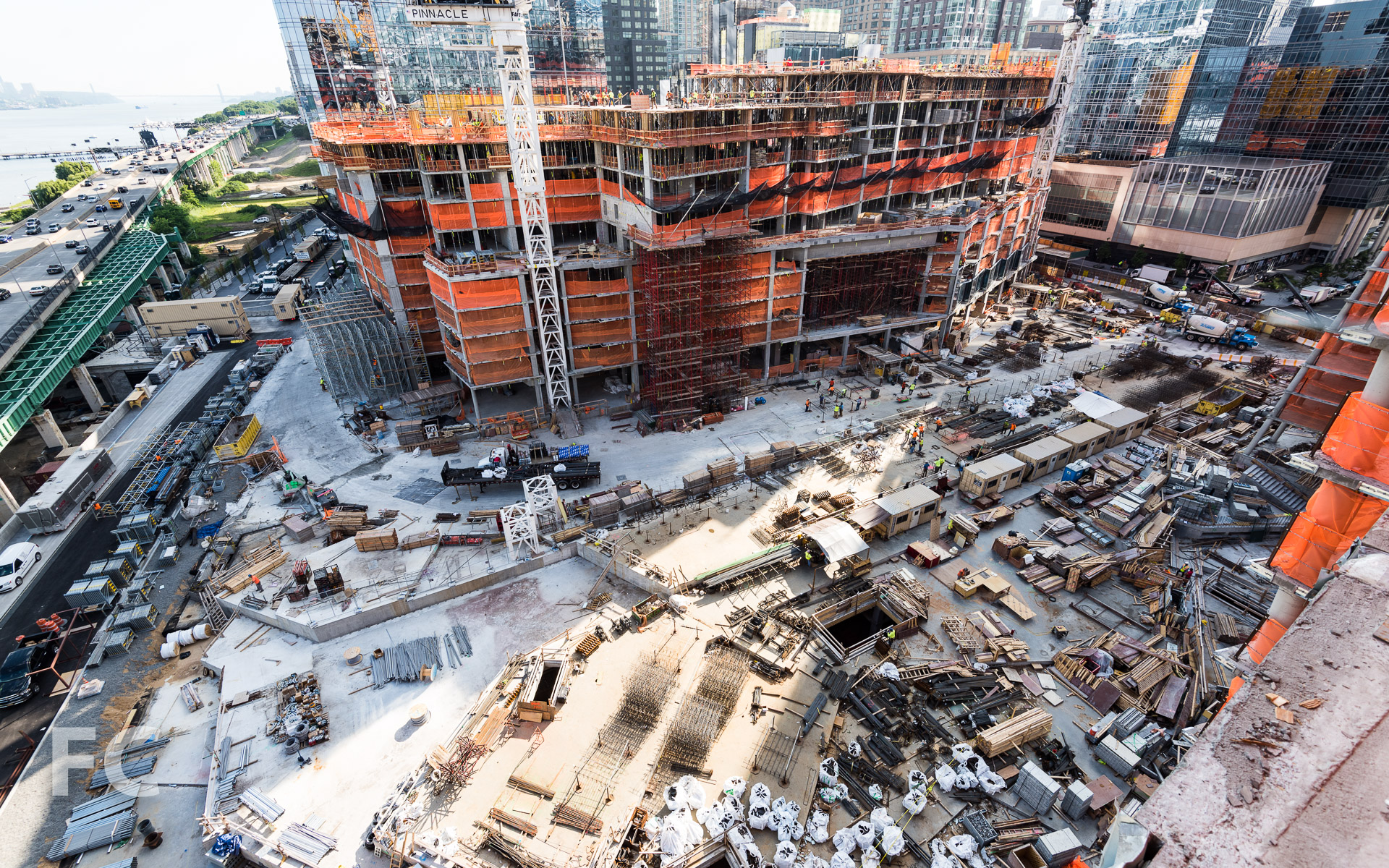 The logistics of a three-tower construction site atop the future open space.