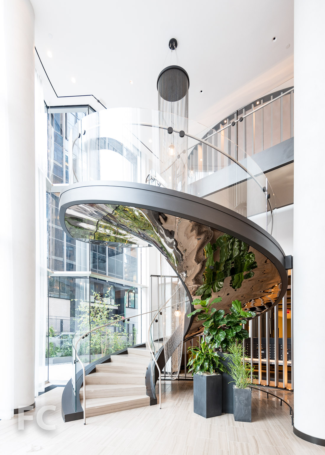Double helix stair to the residential amenities.
