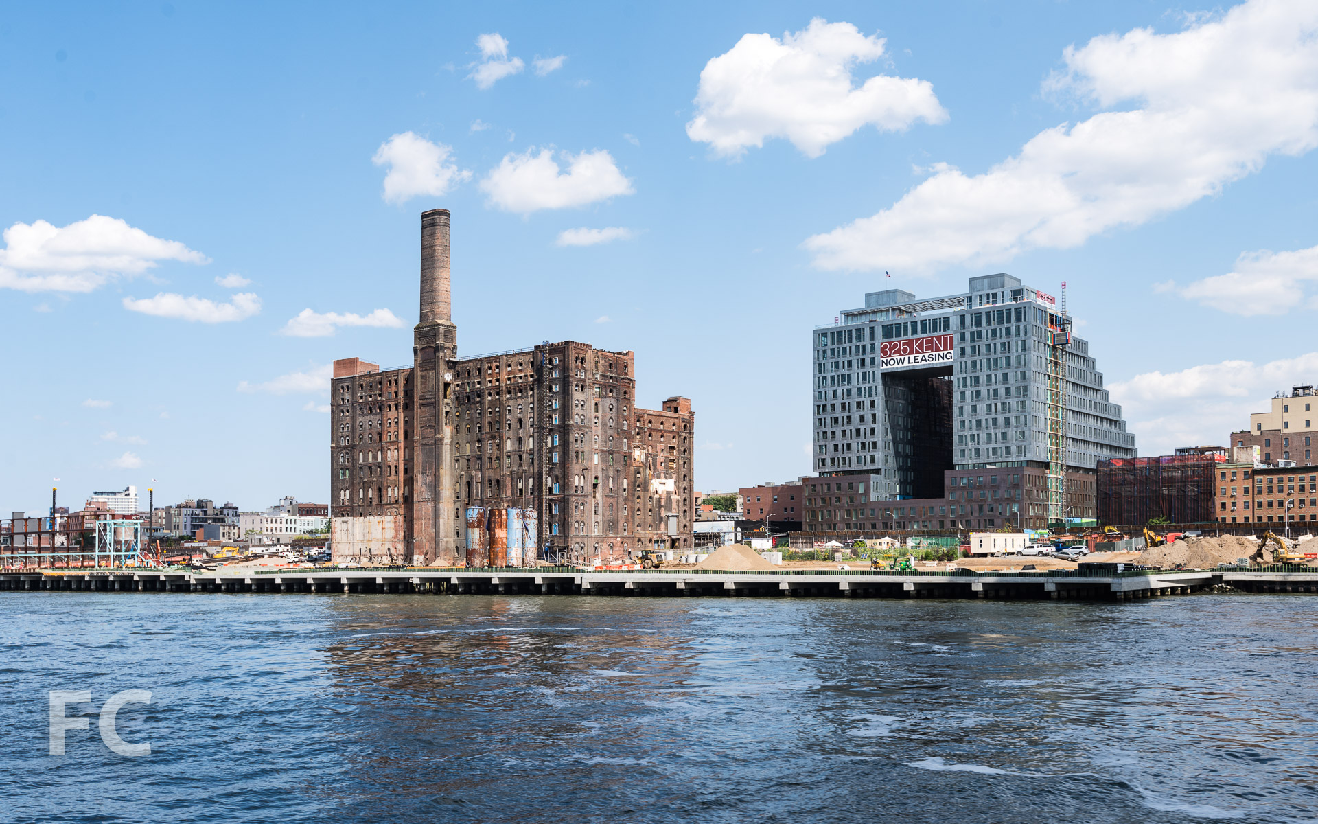 The Domino Sugar Refinery (left) and 325 Kent (right) from the East River.