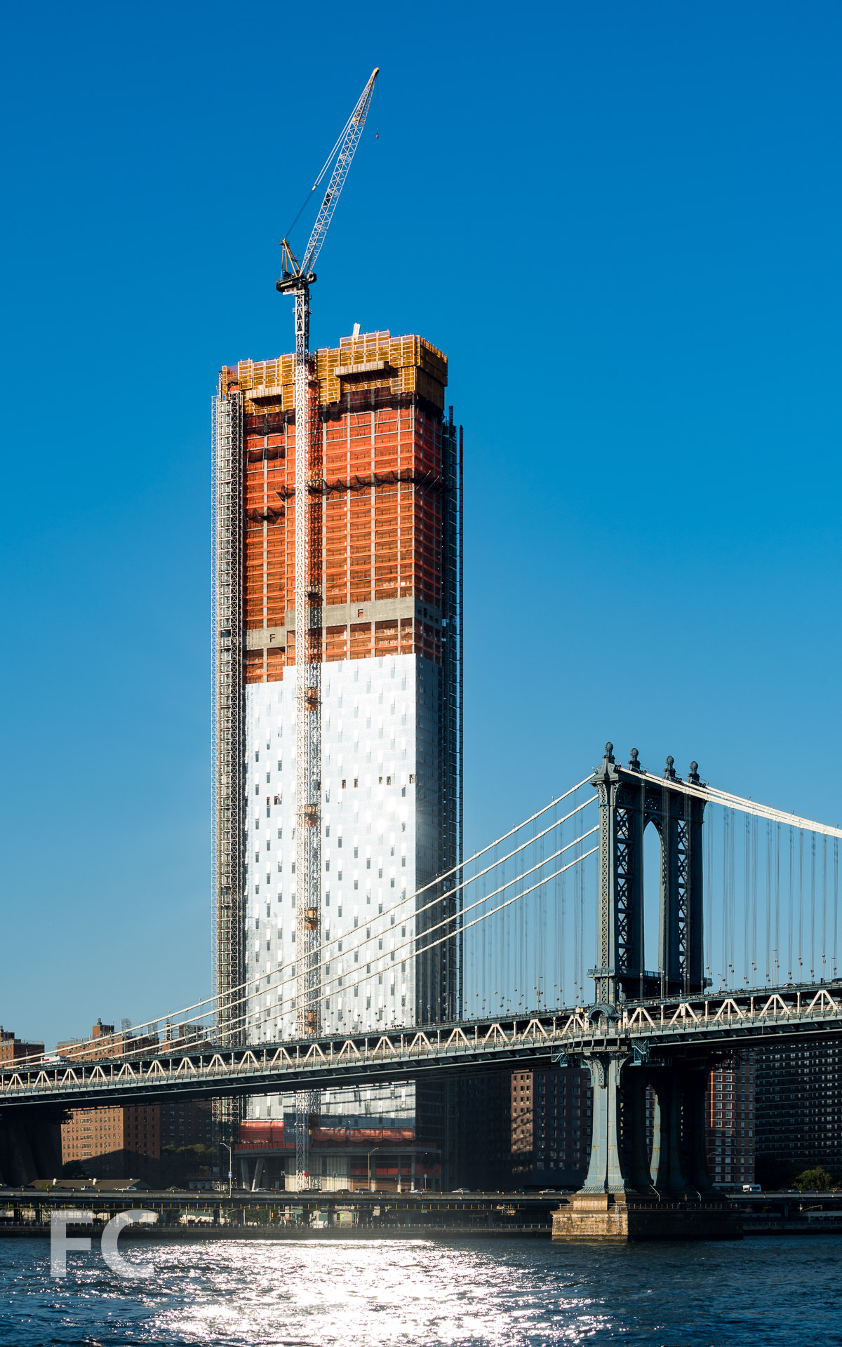 Southwest corner of the tower (left) and the Manhattan Bridge (right) from the East River.