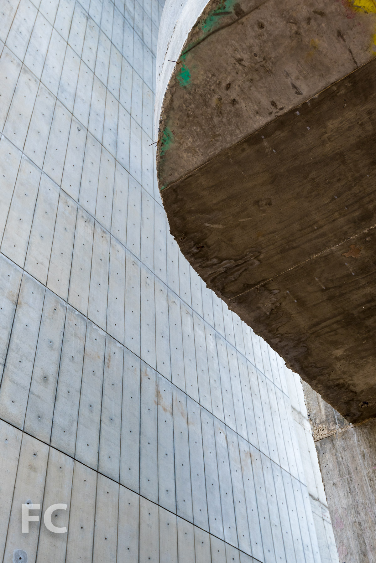 Close-up of the rounded corner of a concrete slab.