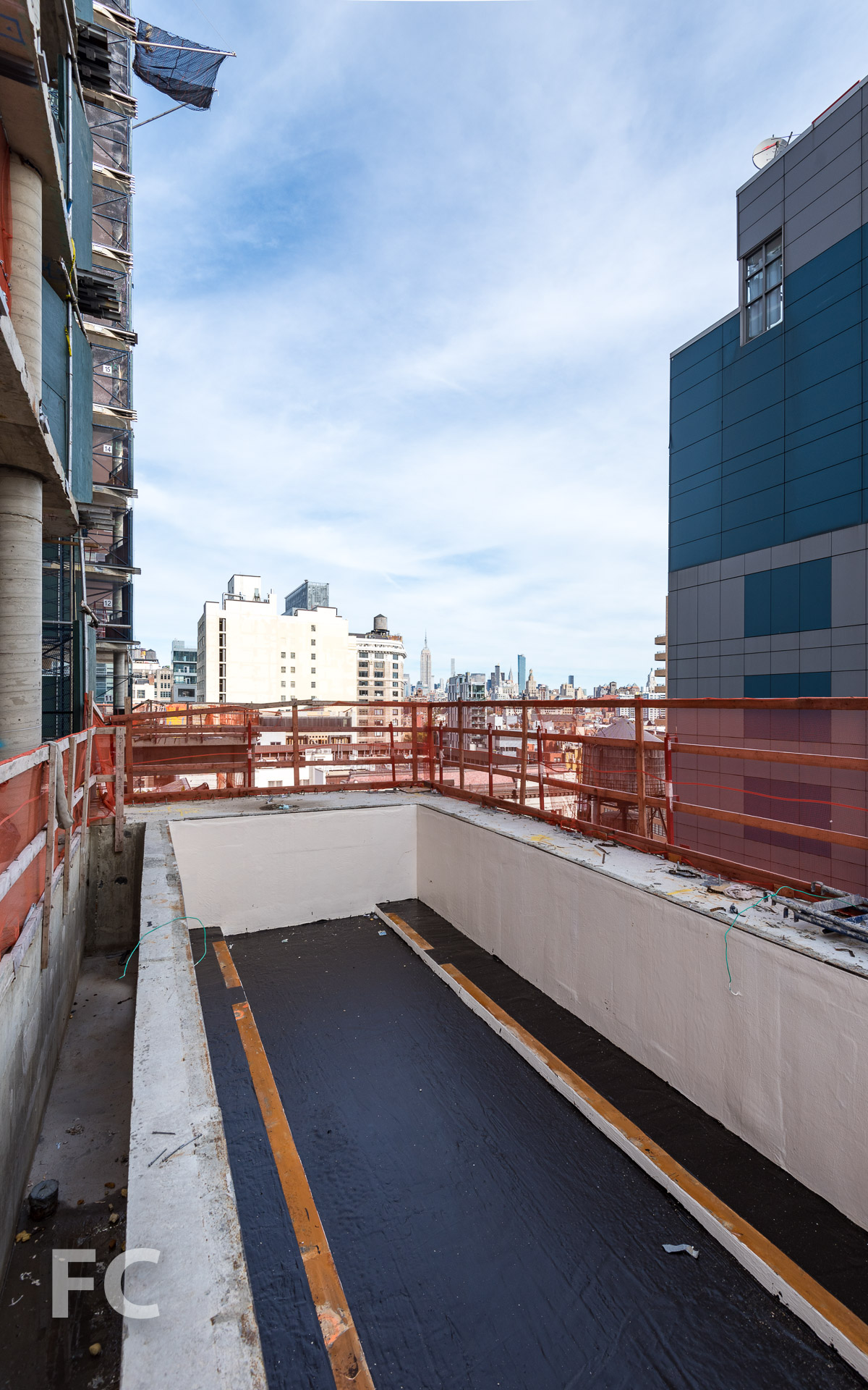 An outdoor pool under construction on the 11th floor terrace.
