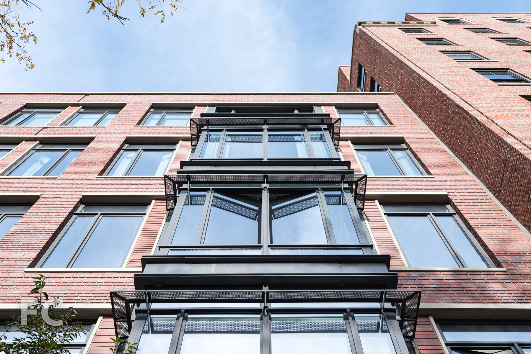 Looking up at the south façade of 155 West 11th Street.