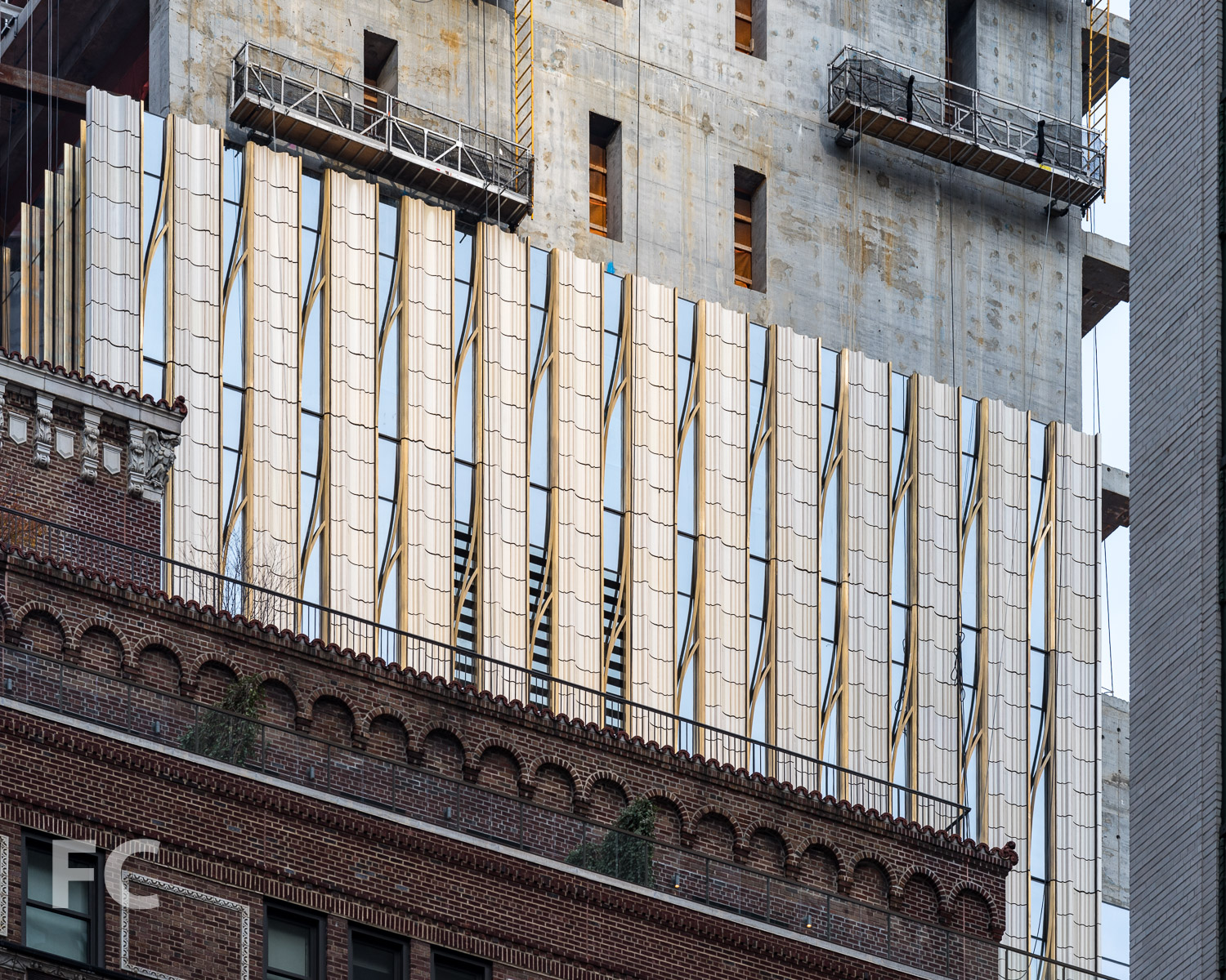 Close-up of the east terra-cotta and glass facade.