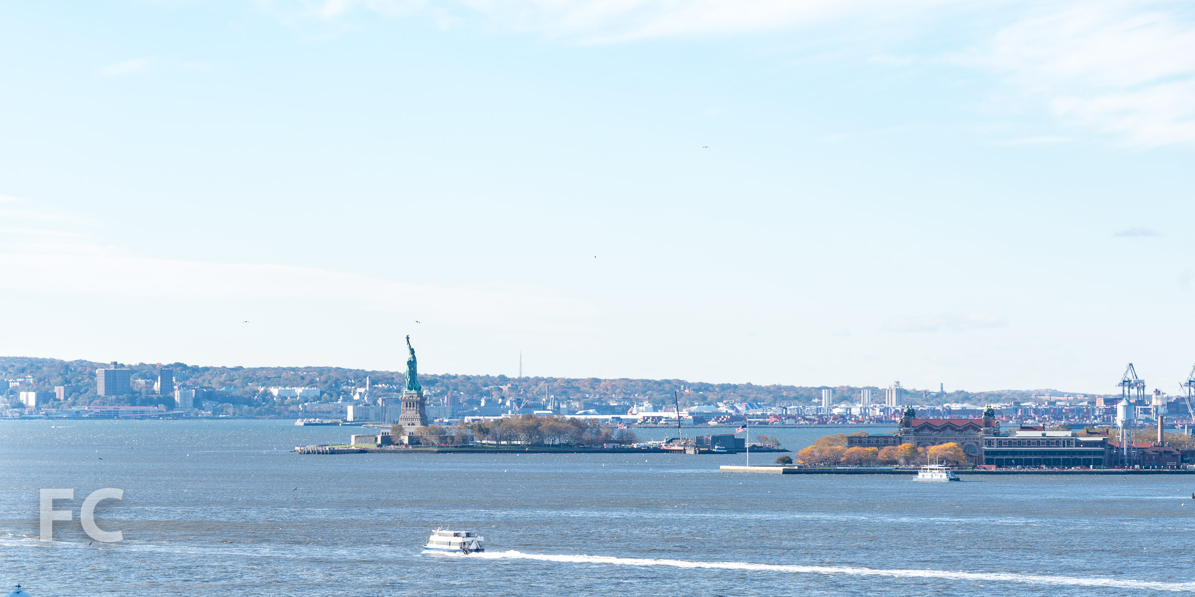 View southwest from the rooftop terrace  towards the Statue of Liberty.