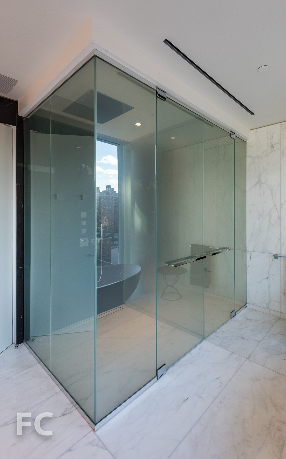 Shower and toilet enclosure in the master bathroom.