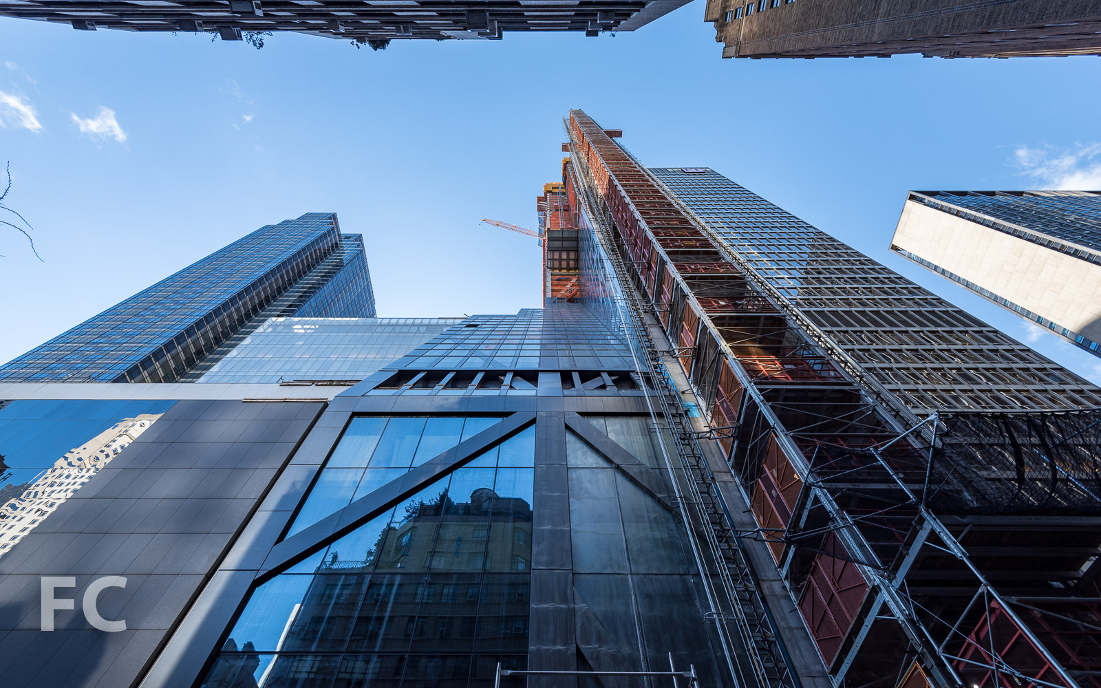 Looking up at the north façade from West 54th Street.