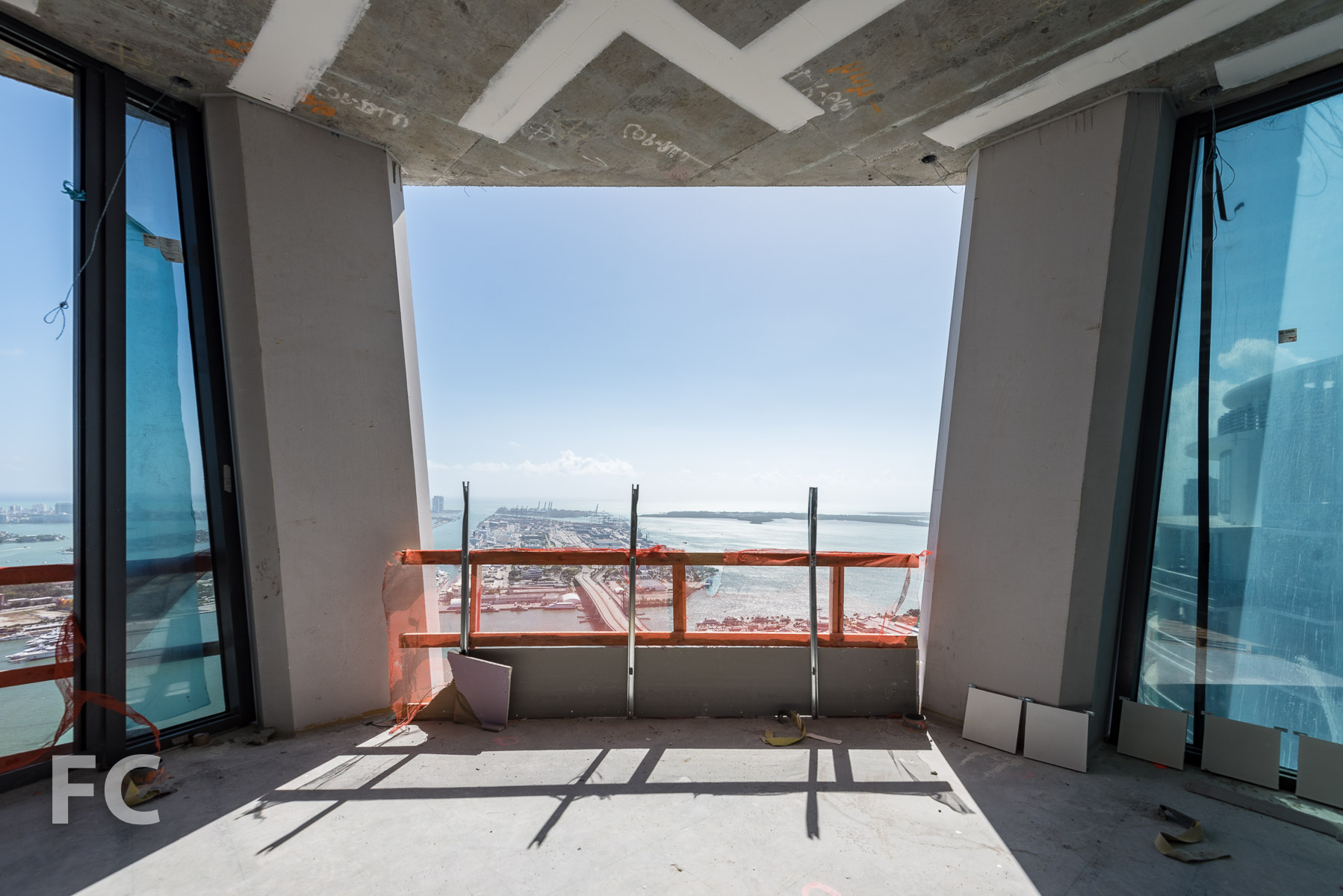 Southeast corner view from a penthouse interior.
