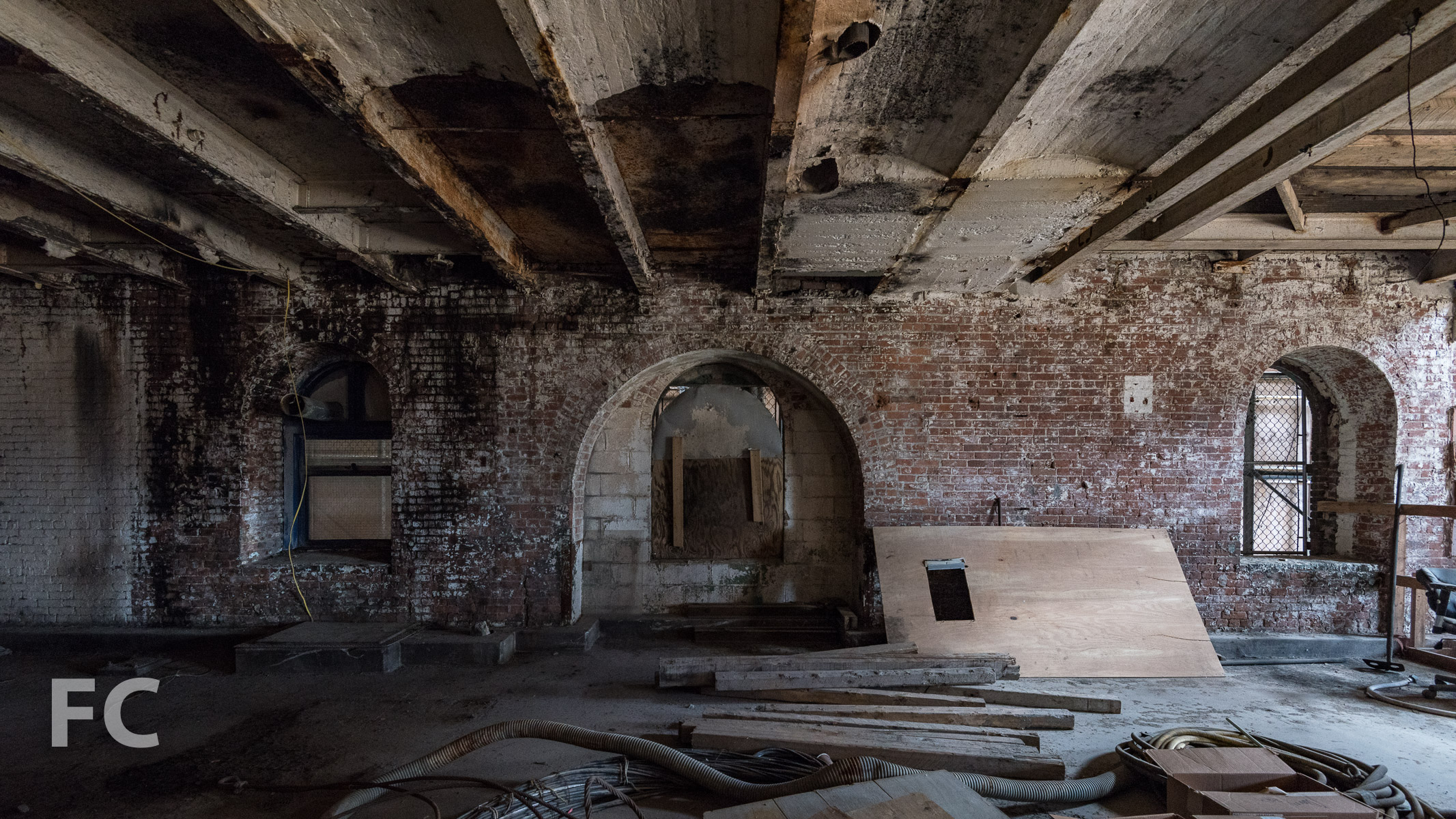 Inside the refinery building before renovation begins.
