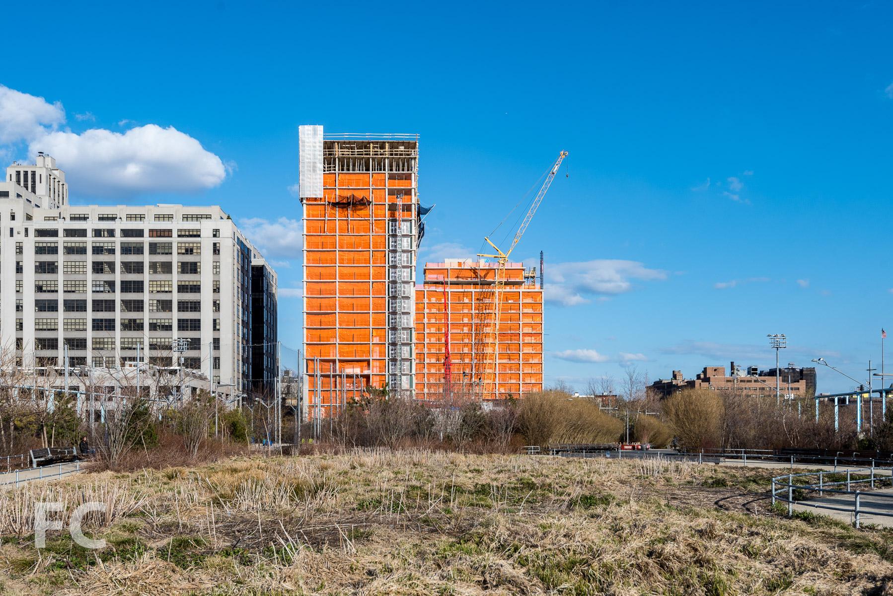 West facade of 15 Bridge Park Drive (right) and 50 Bridge Park Drive (left) from Pier 6 at Brooklyn Bridge Park.