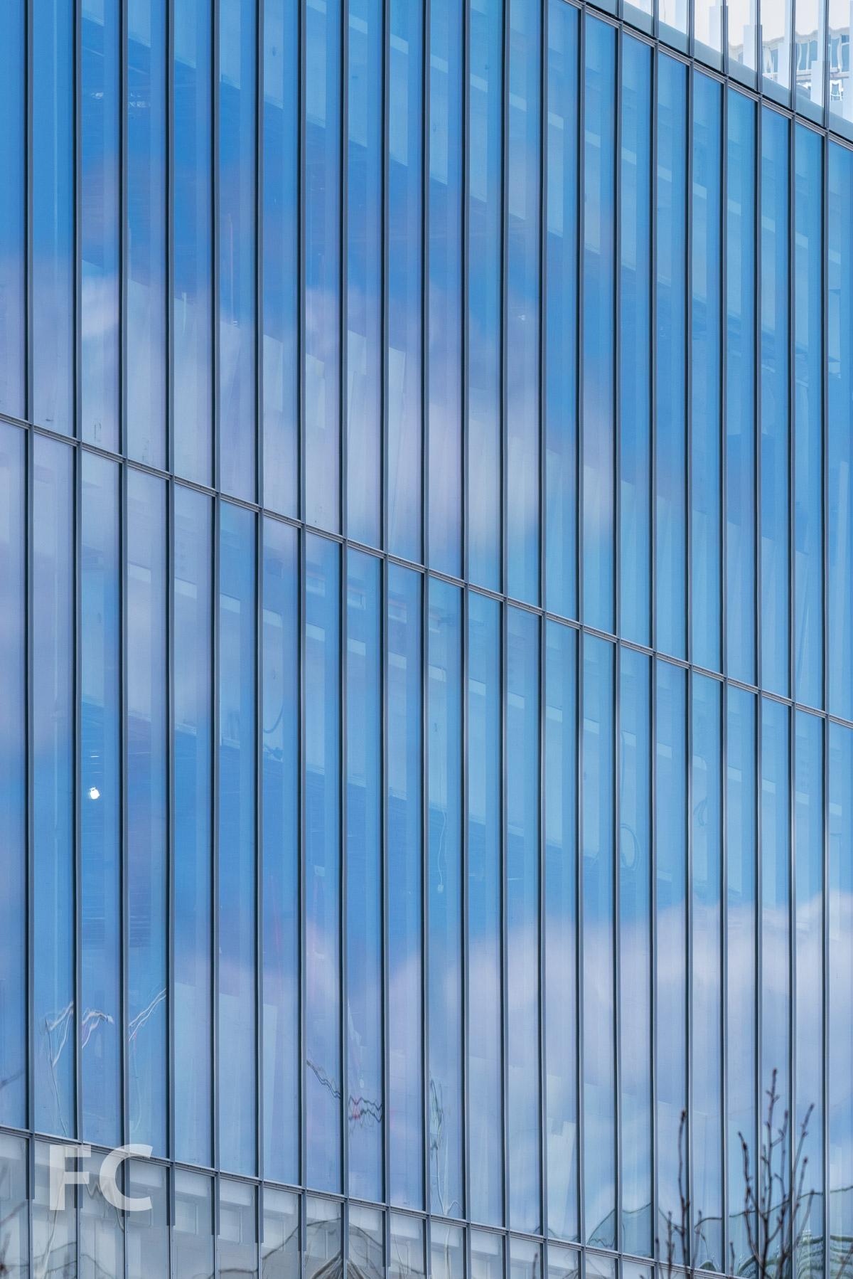 Glass curtain wall facade close-up.