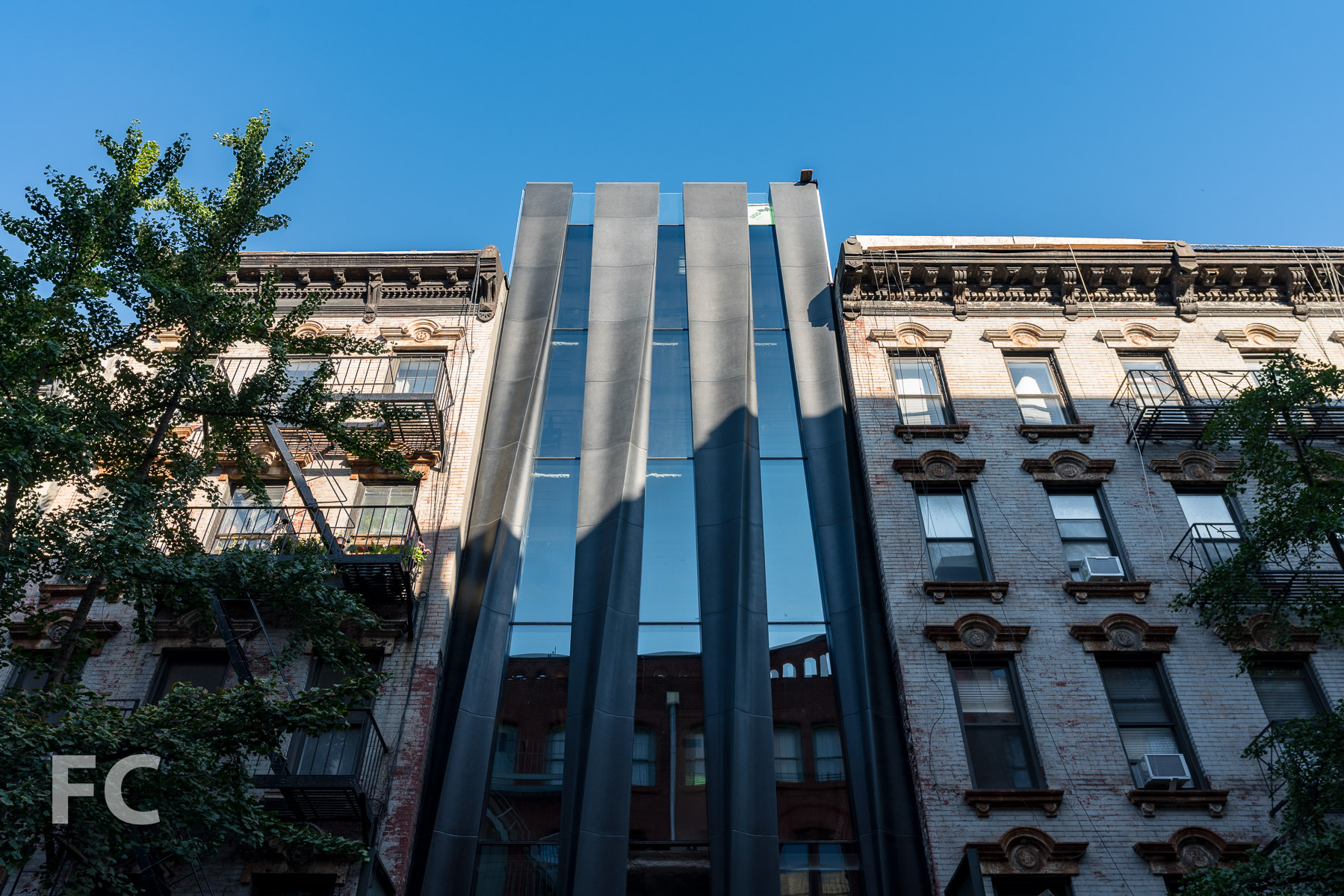 Looking up at the east facade on Mott Street.