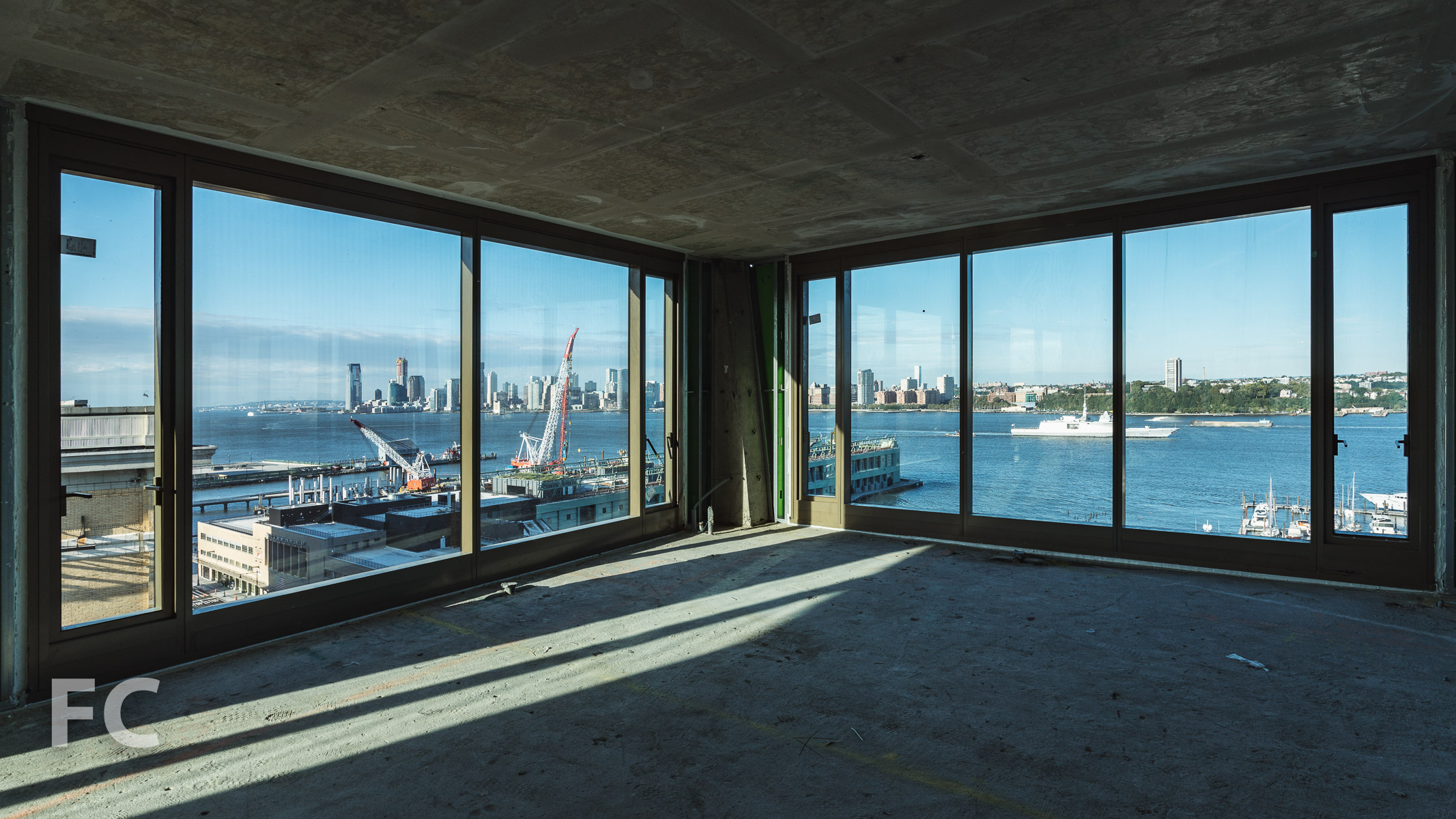 View of the Hudson River waterfront from a southwest corner unit.