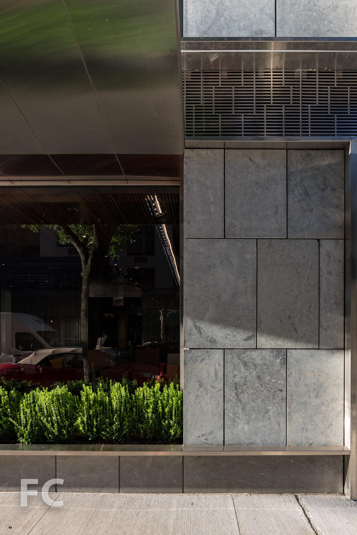 Residential entry facade detail.