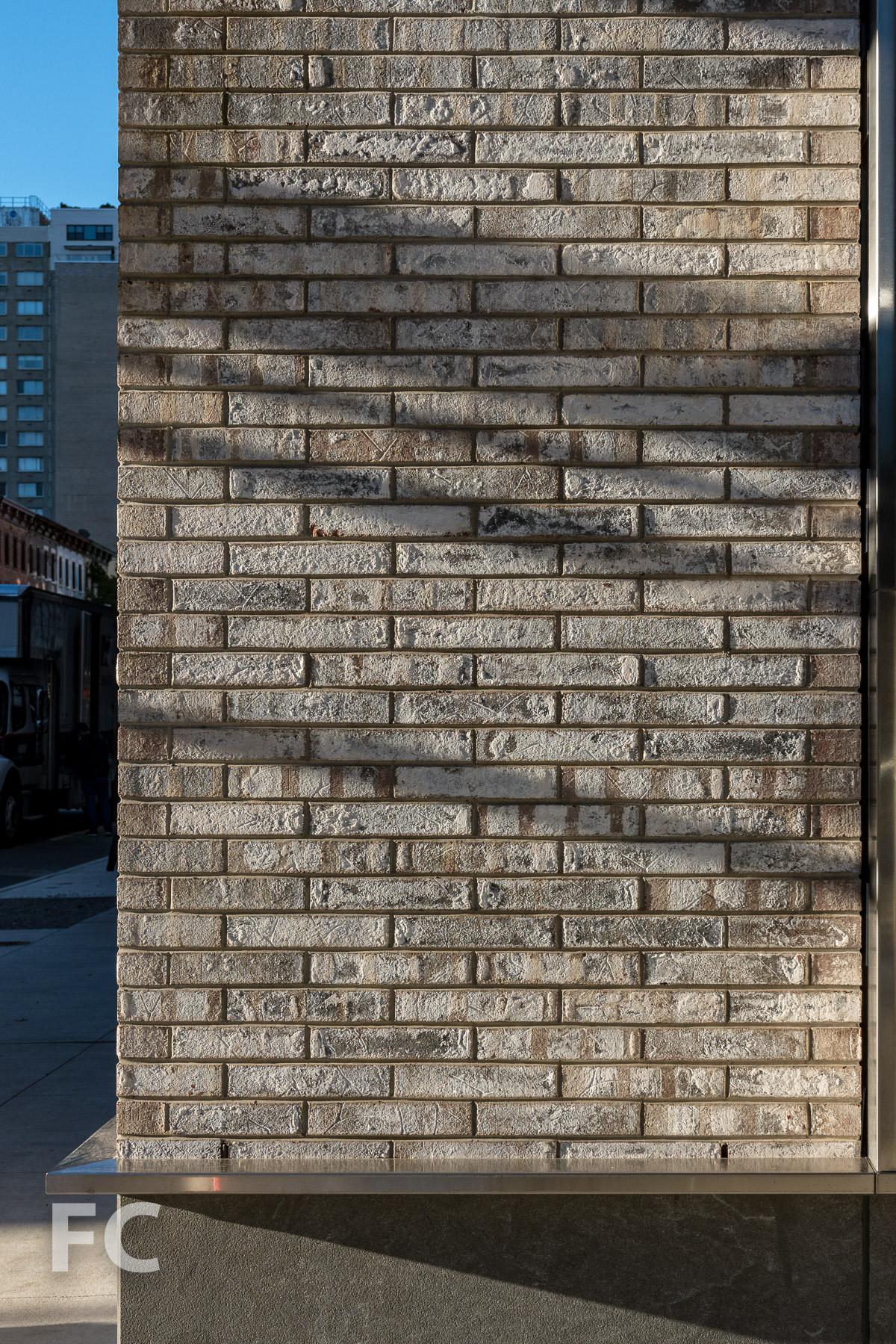 Brick facade detail at the ground floor.