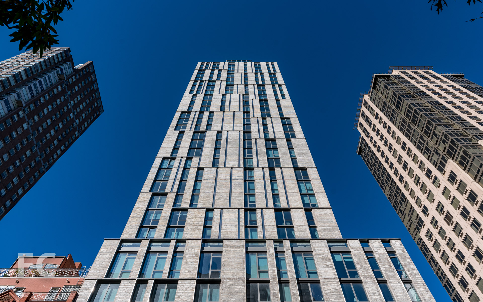 Looking up at the east facade from First Avenue.