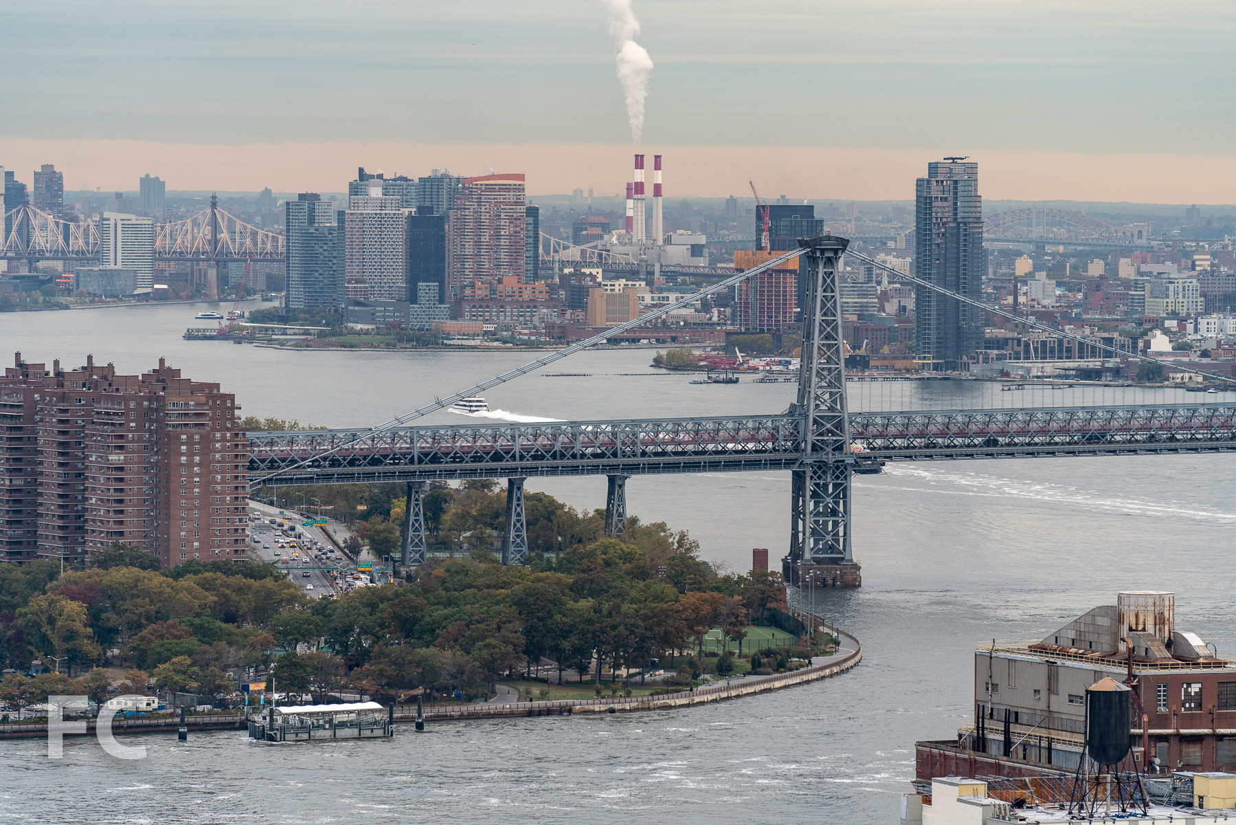 View towards the Lower East Side and the Brooklyn and Queens waterfront from the residential amenity terrace.
